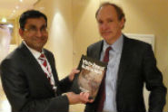 Badrul Khan presented his best-selling Web-Based Instruction book to Sir Tim Berners-Lee, the inventor of the Web.